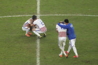 Paraguay's players embrace after their 3-4 los against Brazil in a penalty shoot-out in a Copa America quarterfinal soccer match at the Arena do Gremio in Porto Alegre, Brazil, Thursday, June 27, 2019. Brazil qualified to the semifinals. (AP Photo/Ricardo Mazalan)