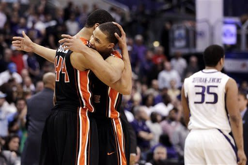 Oregon State's Devon Collier, left, and Jared Cunningham hug as they celebrate their team's 86-84 win against Washington in an NCAA college basketball game at the Pac-12 Conference tournament in Los Angeles, Thursday, March 8, 2012. (AP Photo/Jae C. Hong)