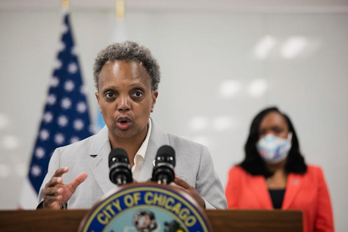 Chicago Mayor Lori Lightfoot, joined by Chicago Public Schools CEO Dr. Janice K. Jackson, right rear, announce a preliminary reopening framework for public schools during a press conference, Friday, July 17, 2020, at CPS Headquarters in Chicago.