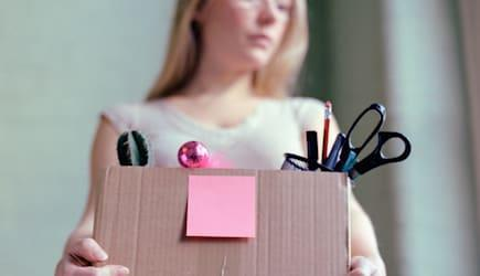 Woman carrying box of stationery