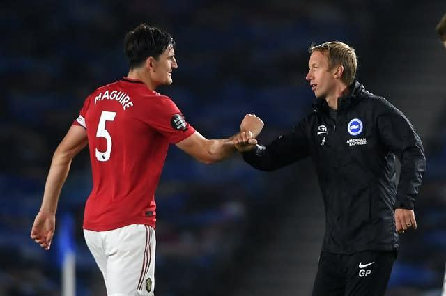 Potter congratulates Harry Maguire after the defeat by Manchester United (Mike Hewitt/NMC Pool)