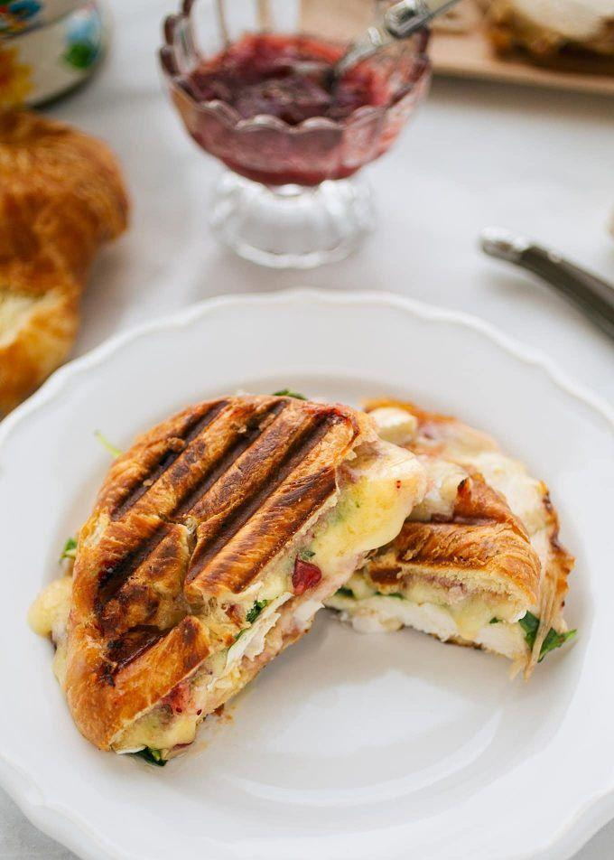 """<p>A buttery croissant makes this sandwich extra delicious. Of course, you could also use leftover rolls as the bun, too.</p><p><strong>Get the recipe at <a href=""""https://stripedspatula.com/turkey-croissant-panini/"""" rel=""""nofollow noopener"""" target=""""_blank"""" data-ylk=""""slk:Striped Spatula"""" class=""""link rapid-noclick-resp"""">Striped Spatula</a>.</strong></p><p><strong><a class=""""link rapid-noclick-resp"""" href=""""https://www.amazon.com/Cuisinart-GR-4N-Griddler-Silver-Black/dp/B002YD99Y4/?tag=syn-yahoo-20&ascsubtag=%5Bartid%7C10050.g.1064%5Bsrc%7Cyahoo-us"""" rel=""""nofollow noopener"""" target=""""_blank"""" data-ylk=""""slk:SHOP PANINI PRESSES"""">SHOP PANINI PRESSES</a><br></strong></p>"""