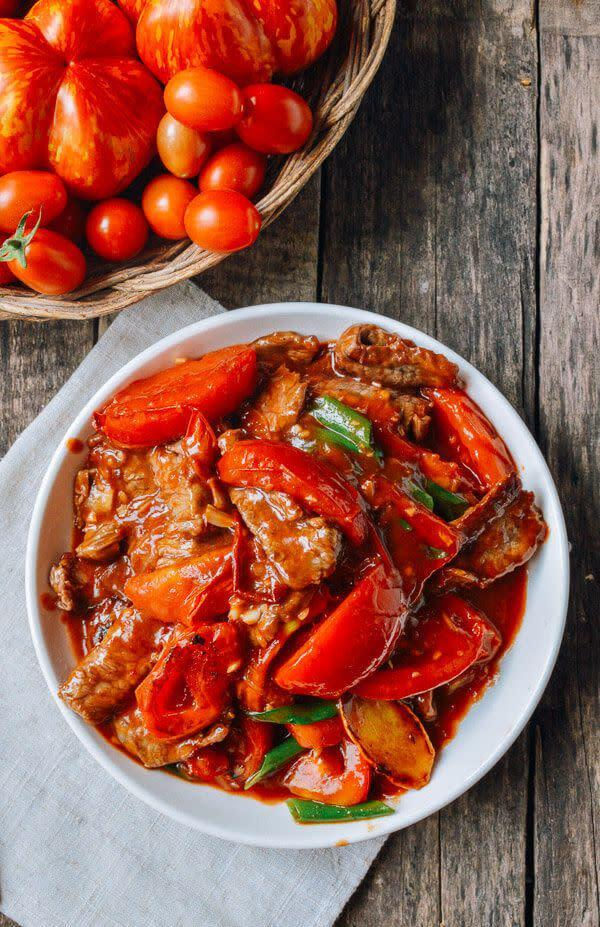 """<strong>Get the <a href=""""http://thewoksoflife.com/2015/08/beef-tomato-stir-fry/"""" rel=""""nofollow noopener"""" target=""""_blank"""" data-ylk=""""slk:Beef Tomato Stir Fry recipe"""" class=""""link rapid-noclick-resp"""">Beef Tomato Stir Fry recipe</a>&nbsp;from The Woks of Life</strong>"""