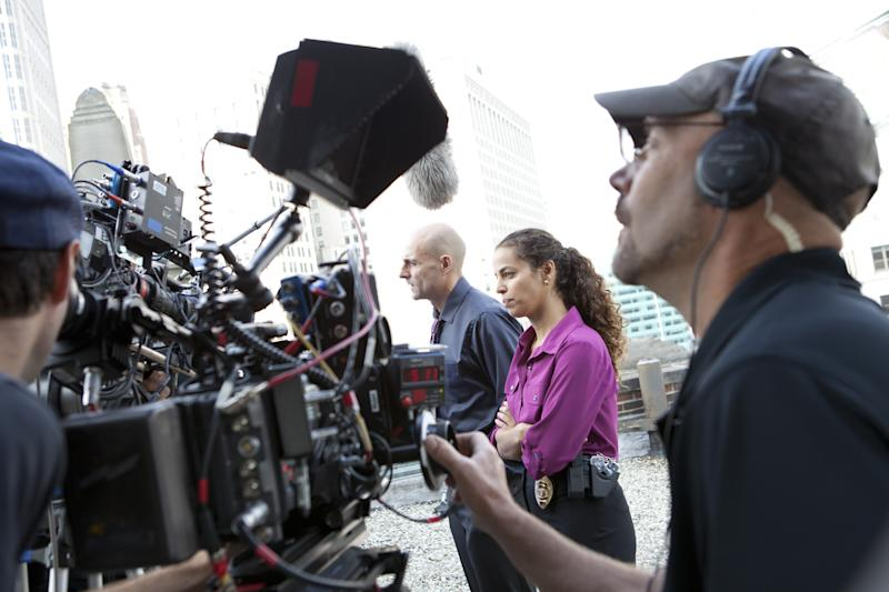 "This image released by AMC shows Mark Strong, center left, and Athena Karkanis on the set of ""Low Winter Sun."" The series, premiering Sunday, Aug. 11, revives a two-part U.K. miniseries from 2006. It also marks Hollywood's return to the Motor City as a place to explore crime, following ABC's ""Detroit 1-8-7."" It aired during the 2010-11 season. (AP Photo/AMC, Alicia Gbur)"
