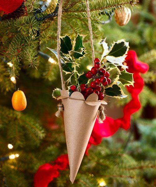 """<p>Place faux red berries and soft green holly leaves inside of this adorbs little holder. </p><p>Get the tutorial at <em><a href=""""http://www.goodhousekeeping.com/holidays/christmas-ideas/how-to/a17808/cornucopia-christmas-ornament/"""" rel=""""nofollow noopener"""" target=""""_blank"""" data-ylk=""""slk:Good Housekeeping"""" class=""""link rapid-noclick-resp"""">Good Housekeeping</a>.</em></p>"""