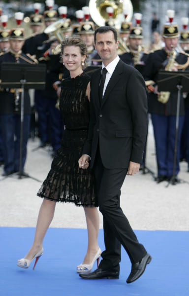 FILE - In this Sunday, July 13, 2008 file photo, Syrian President Bashar Assad and his wife Asma arrive for a formal dinner after a Mediterranean Summit meeting at the Petit Palais in Paris. As Syria's bloodshed deepens, the country's British-born first lady has become an object of contempt for many, a Marie Antoinette figure who shopped online for fondue sets and 6-inch, crystal-encrusted Christian Louboutin heels while her country burned. The EU has slapped sanctions on Asma Assad, the young, stylish wife who for a decade offered a veneer of respectability to one of the world's most secretive and ruthless dictatorships. (AP Photo/Thibault Camus, File)