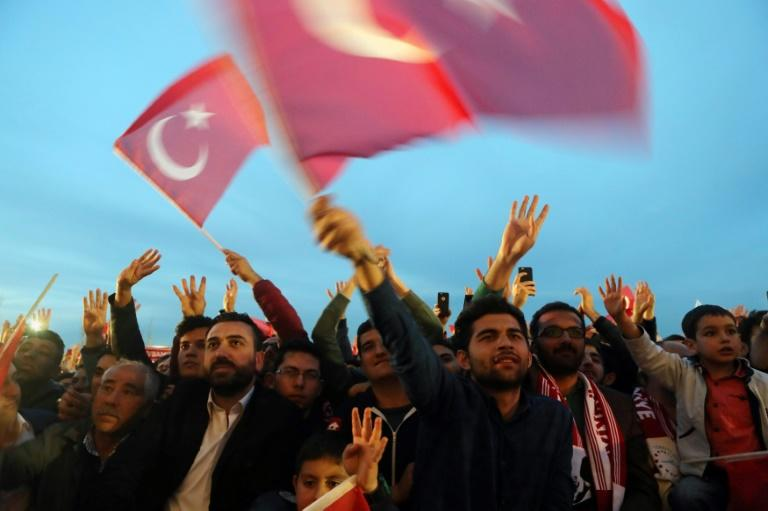 Erdogan supporters waving flags after his victory