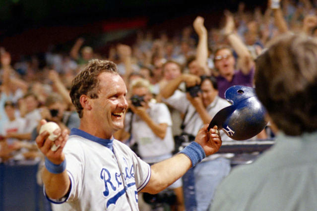 FILE - In this Sept. 30, 1992, file photo, Kansas City Royals' George Brett holds the ball he hit as he heads toward the Royals' dugout after hitting his 3,000th career hit, against the California Angels in Anaheim, Calif. Baseball's amateur draft this week will look much different because of the coronavirus pandemic, and more permanent changes could be coming soon. (AP Photo/Kevork Djansezian, File)