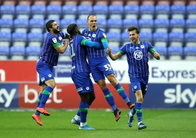 Kal Naismith (second right) netted a brace for Wigan (Martin Rickett/PA).