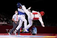 <p>Farzad Mansoori (L) of Team Afghanistan competes against In Kyo-don of Team South Korea during the Men's +80kg Taekwondo Round of 16 contest on day four of the Tokyo 2020 Olympic Games at Makuhari Messe Hall on July 27, 2021 in Chiba, Japan. (Photo by Maja Hitij/Getty Images)</p>