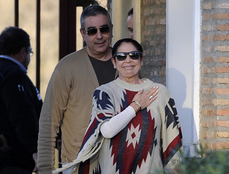 Spanish popular singer Isabel Pantoja (R) gestures next to her brother Agustin as she leaves the jail of Alcala de Guadaira, near Sevilla after being released on March 2, 2015.   The Popular Spanish singer Isabel Pantoja was arrested on April 2013 and sentenced to two years in prison and a fine of 1.15 million euros for money laundering and embezzlement.  / AFP / CRISTINA QUICLER        (Photo credit should read CRISTINA QUICLER/AFP via Getty Images)