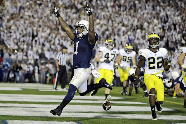 Penn State running back Bill Belton (1) runs a two-yard touchdown as Michigan safety Jarrod Wilson (22) tries to defend during the fourth overtime period in an NCAA college football game in State College, Pa., Saturday, Oct. 12, 2013. Penn State won 43-40. (AP Photo/Gene J. Puskar)