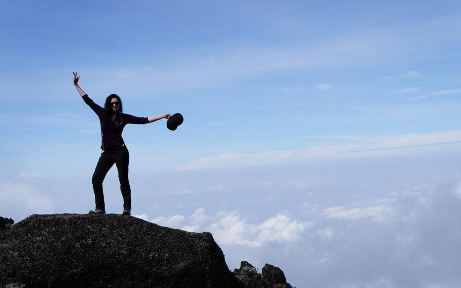 <p>My best friend, Terasa Sciortino, wanted me to jump up onto this rock and show off the beautiful terrain above the clouds.</p>