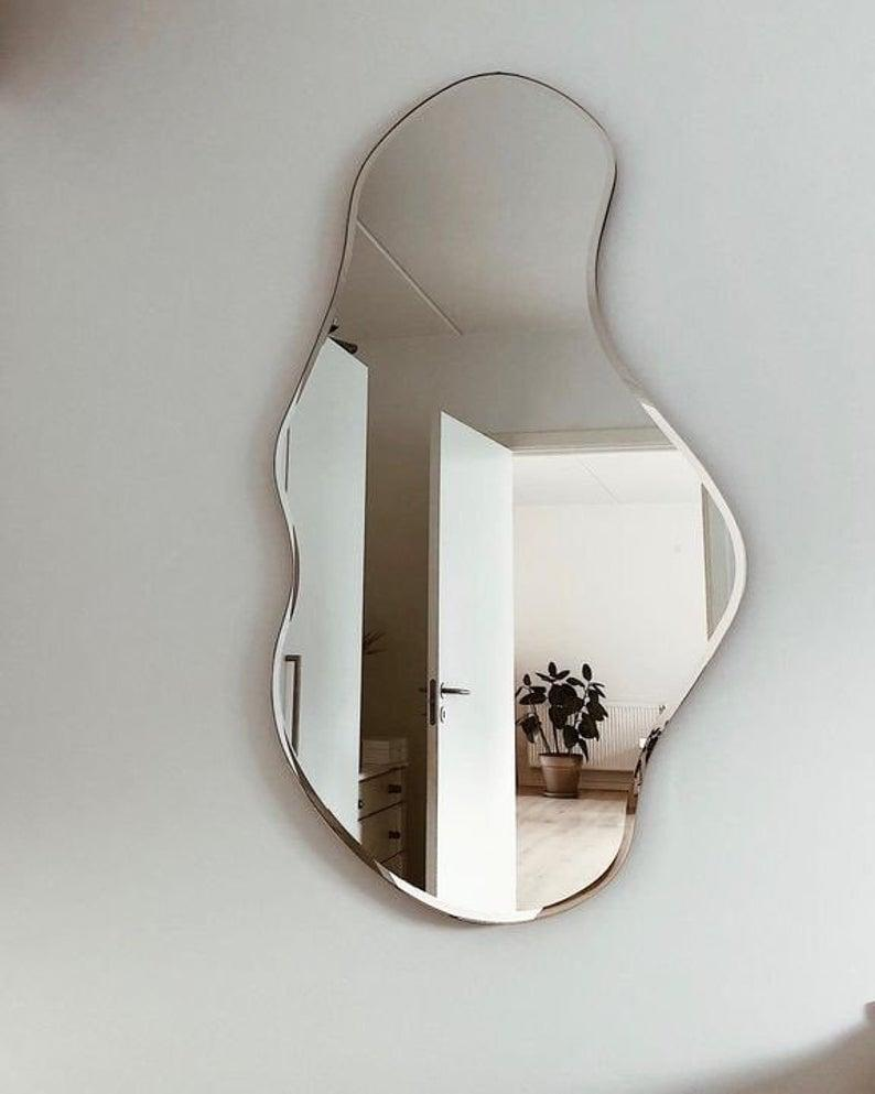 <p>This <span>MirrorHomeArtDecor Asymmetrical Mirror</span> ($187 and up, originally $249) will add visual interest to your entryway.</p>