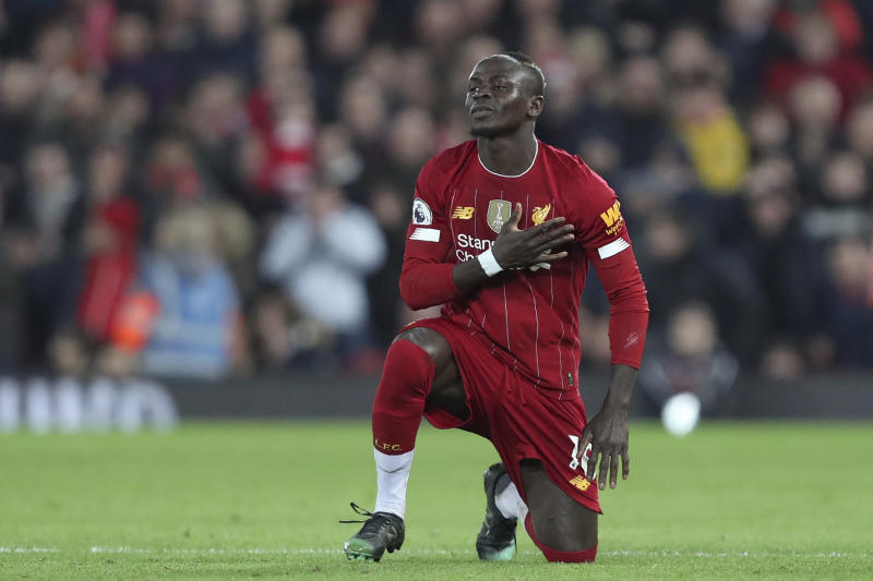 Liverpool's Sadio Mane celebrates after scoring the opening goal during the English Premier League soccer match between Liverpool and Wolverhampton Wanderers at Anfield Stadium, Liverpool, England, Sunday Dec. 29, 2019. (AP Photo/Jon Super)