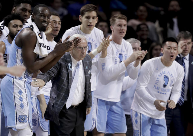 North Carolina head coach Roy Williams and players react after a basket against Miami during the first half of an NCAA college basketball game in the Atlantic Coast Conference men's tournament Thursday, March 8, 2018, in New York. (AP Photo/Julie Jacobson)