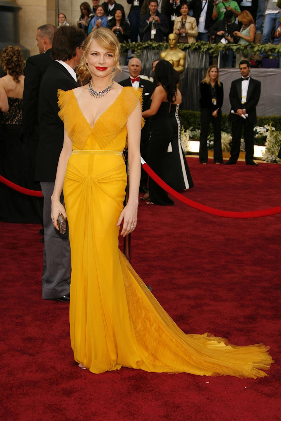 "<p>It's rare that stars opt for a bold colour like yellow for the Oscar red carpet, but Williams expertly pulled off this rich marigold shade to celebrate her Best Supporting Actress nomination for ""Brokeback Mountain.""</p>"