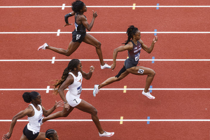 Runners compete in a preliminary heat of the women's 200 meters during the NCAA Division I Outdoor Track and Field Championships, Thursday, June 10, 2021, at Hayward Field in Eugene, Ore. Leading is Ohio State's Anavia Battle. (AP Photo/Thomas Boyd)