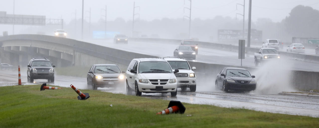 <p>Accumulated rain from what is now Tropical Depression Gordon, makes for a big splash across a frontage road along I-55 in Jackson, Miss., Wednesday, Sept. 5, 2018. (Photo: Rogelio V. Solis/AP) </p>