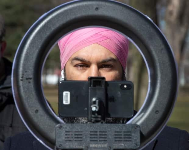 NDP Leader Jagmeet Singh adjusts his webcam before a news conference on March 29 in Montreal. (Ryan Remiorz/Canadian Press - image credit)