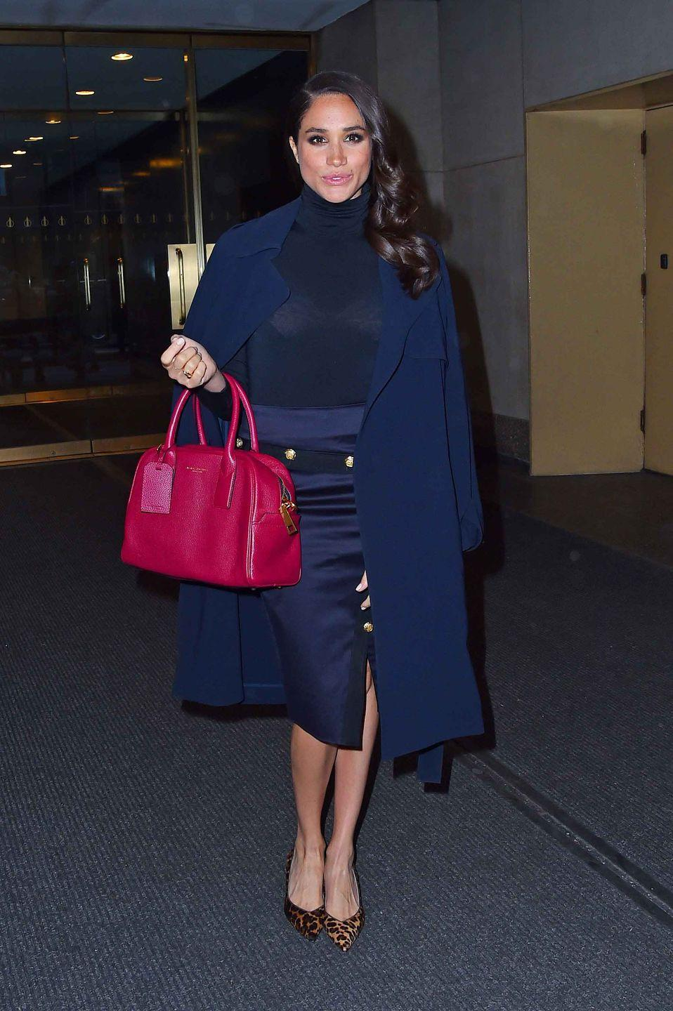 """<p>Markle wears a navy ensemble paired with a cranberry red purse and <a href=""""https://go.redirectingat.com?id=74968X1596630&url=https%3A%2F%2Fwww.sarahflint.com%2Fproducts%2Femma-chocolate-leopard%3Fvariant%3D37841859521&sref=https%3A%2F%2Fwww.townandcountrymag.com%2Fstyle%2Ffashion-trends%2Fg3272%2Fmeghan-markle-preppy-style%2F"""" rel=""""nofollow noopener"""" target=""""_blank"""" data-ylk=""""slk:leopard print pumps from Sarah Flint"""" class=""""link rapid-noclick-resp"""">leopard print pumps from Sarah Flint</a>.</p><p><a class=""""link rapid-noclick-resp"""" href=""""https://go.redirectingat.com?id=74968X1596630&url=https%3A%2F%2Fwww.sarahflint.com%2Fproducts%2Femma-chocolate-leopard%3Fvariant%3D37841859521&sref=https%3A%2F%2Fwww.townandcountrymag.com%2Fstyle%2Ffashion-trends%2Fg3272%2Fmeghan-markle-preppy-style%2F"""" rel=""""nofollow noopener"""" target=""""_blank"""" data-ylk=""""slk:SHOP NOW"""">SHOP NOW</a> <em>Emma Block Heel Pump by Sarah Flint, $375</em><br></p>"""