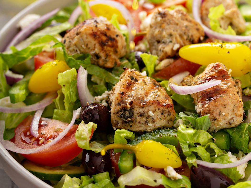 Greek salad with grilled chicken with herbed vinaigrette dressing.