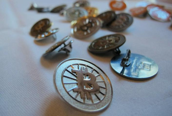 """<span class=""""caption"""">Bitcoins may finally be good for more than just speculation and making buttons. </span> <span class=""""attribution""""><a class=""""link rapid-noclick-resp"""" href=""""https://newsroom.ap.org/detail/GermanyBitcoinCarbonFootprint/188c9970ae5e4023b53510c5df623ab2/photo?Query=bitcoin&mediaType=photo&sortBy=arrivaldatetime:desc&dateRange=Anytime&totalCount=466&currentItemNo=98"""" rel=""""nofollow noopener"""" target=""""_blank"""" data-ylk=""""slk:AP Photo/Frank Jordans"""">AP Photo/Frank Jordans</a></span>"""