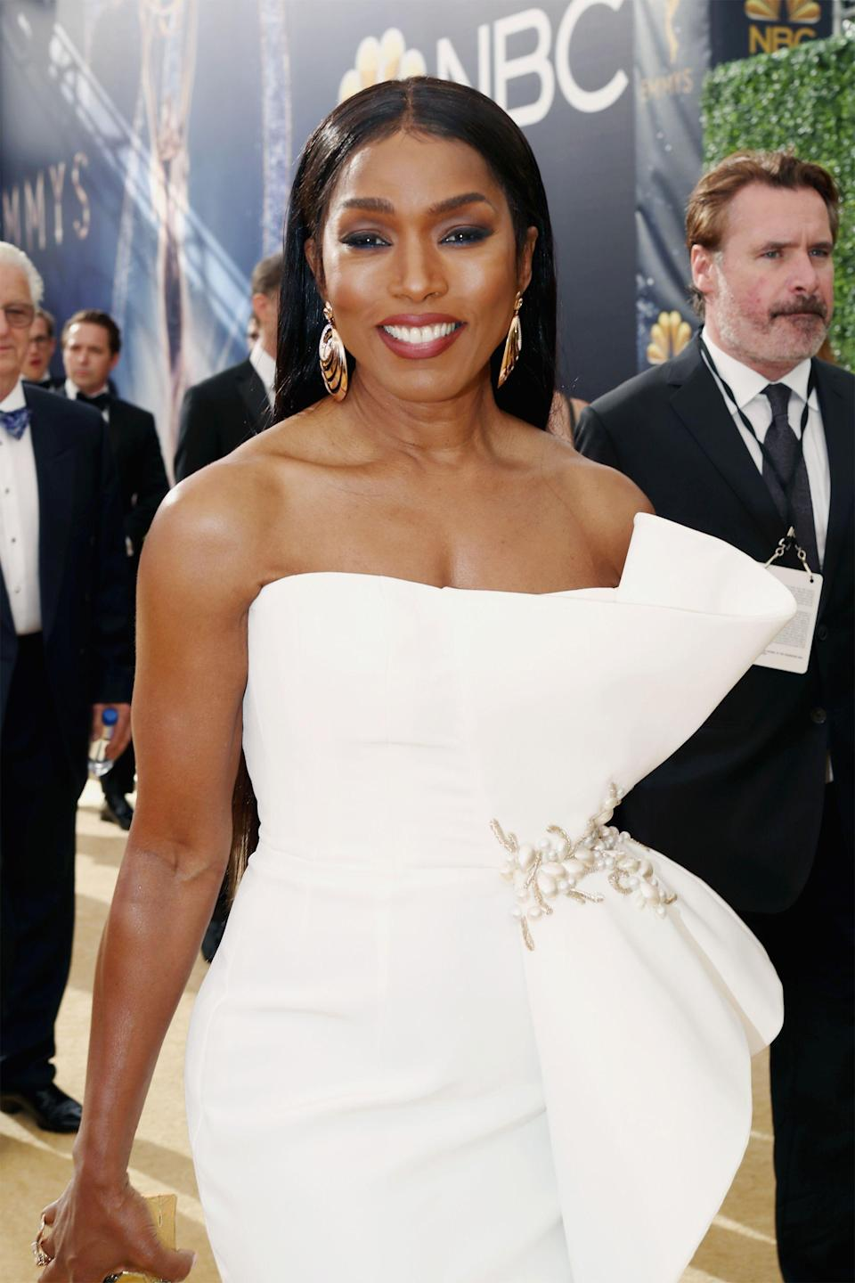 """<p>Angela Bassett's Emmys look was so beautiful, it almost hurt. If you're looking for us, we'll be at home practicing <a href=""""https://www.refinery29.com/en-us/2018/09/210188/angela-bassett-age-skin-beauty-secrets-emmys"""" rel=""""nofollow noopener"""" target=""""_blank"""" data-ylk=""""slk:her skin-care routine"""" class=""""link rapid-noclick-resp"""">her skin-care routine</a> in hopes of looking this good.</p><span class=""""copyright"""">Photo: Rich Polk/Getty Images. </span>"""