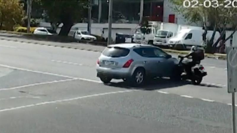The driver can be seen creeping over the intersection. Source: 7 News