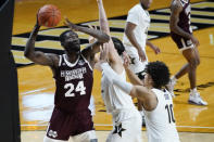 Mississippi State forward Abdul Ado (24) drives against Vanderbilt's Quentin Millora-Brown, center, and Myles Stute (10) in the second half of an NCAA college basketball game Saturday, Jan. 9, 2021, in Nashville, Tenn. (AP Photo/Mark Humphrey)