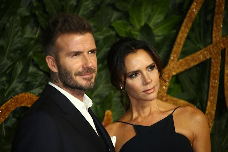 Former soccer player David Beckham, left, and designer Victoria Beckham pose for photographers upon arrival at the The Fashion Awards 2018 in central London, Monday, Dec. 10, 2018. (Photo by Joel C Ryan/Invision/AP)