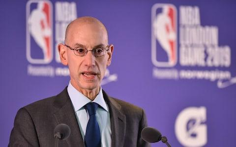 """The NBA backs """"freedom of expression,"""" its commissioner Adam Silver insisted earlier this week - Credit: GLYN KIRK/AFP"""