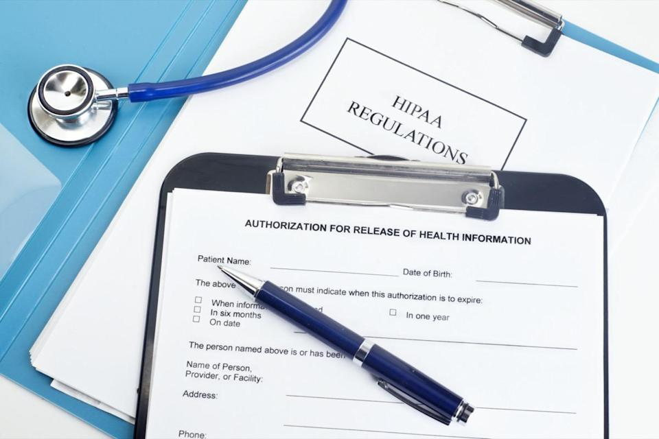 Patient release of information form with HIPAA regulations and documents. .
