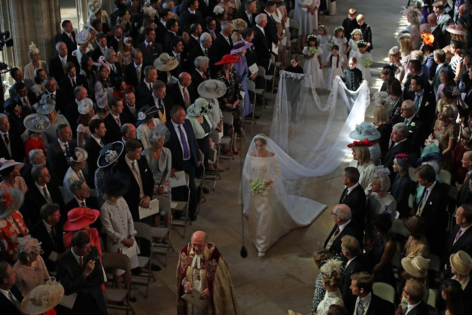 Meghan Markle walks down the aisle. (Photo: Danny Lawson/Getty Images)