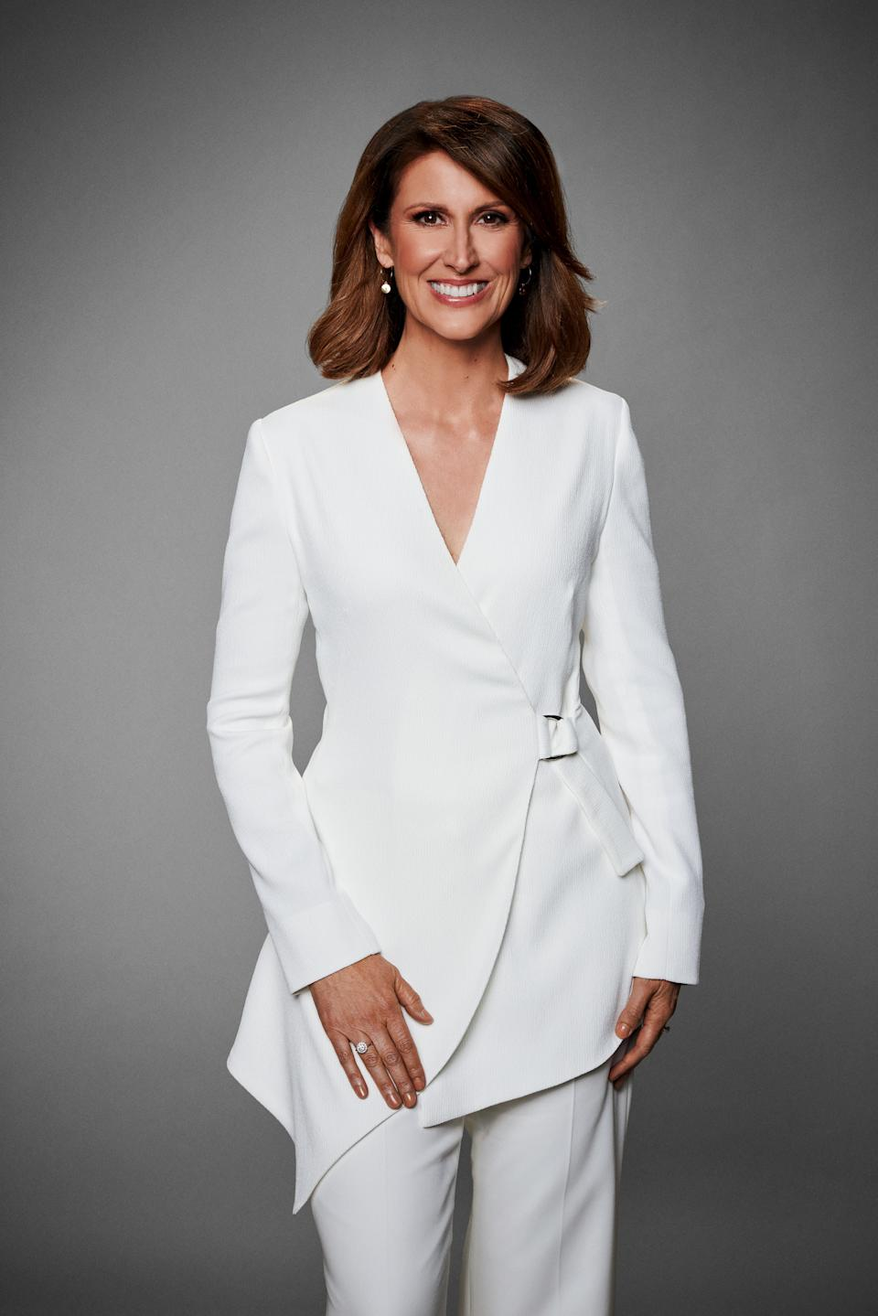 Natalie Barr in a white suit