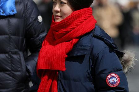 A woman wears a Canada Goose jacket at Times Square in New York