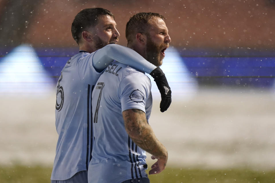 Sporting Kansas City's Johnny Russell (7) celebrates with teammate Ilie Sanchez (6) after scoring against Real Salt Lake in the first half during an MLS soccer match Sunday, Nov. 8, 2020, in Sandy, Utah. (AP Photo/Rick Bowmer)