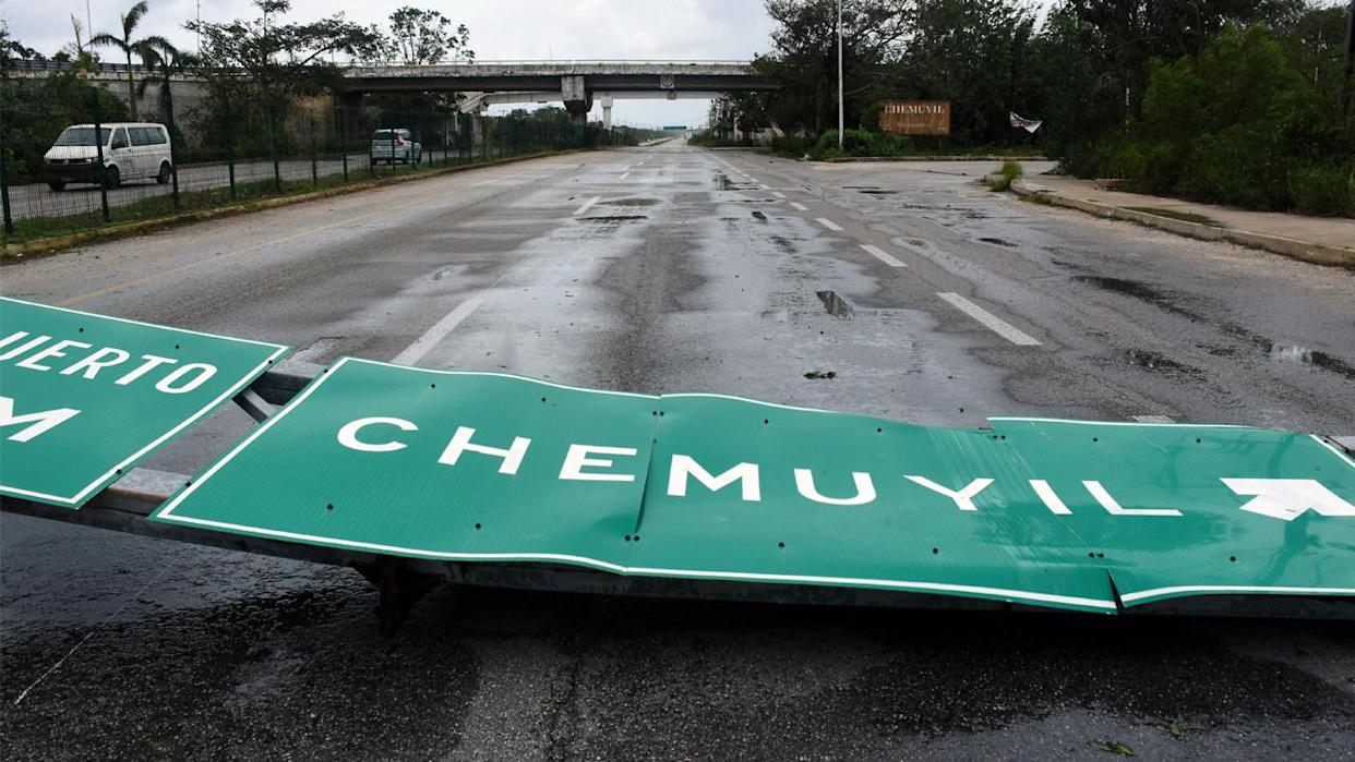 The force of Hurricane Grace knocked down road signs along Mexico's eastern Yucatan Peninsula