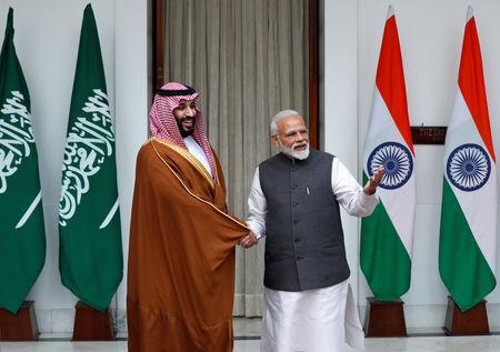 FILE PHOTO: Saudi Crown Prince Mohammed bin Salman shakes hands with Indian Prime Minister Narendra Modi in New Delhi, India, February 20, 2019. REUTERS/Adnan Abidi/File Photo
