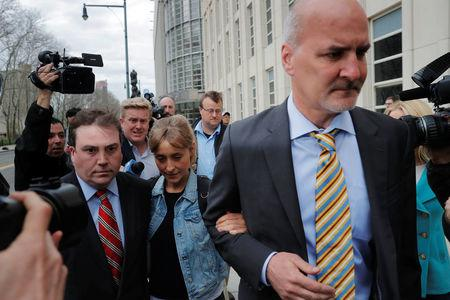 """Actress Allison Mack, known for her role in the TV series """"Smallville"""", departs after being granted bail following being charged with sex trafficking and conspiracy in New York, U.S., April 24, 2018. REUTERS/Lucas Jackson"""