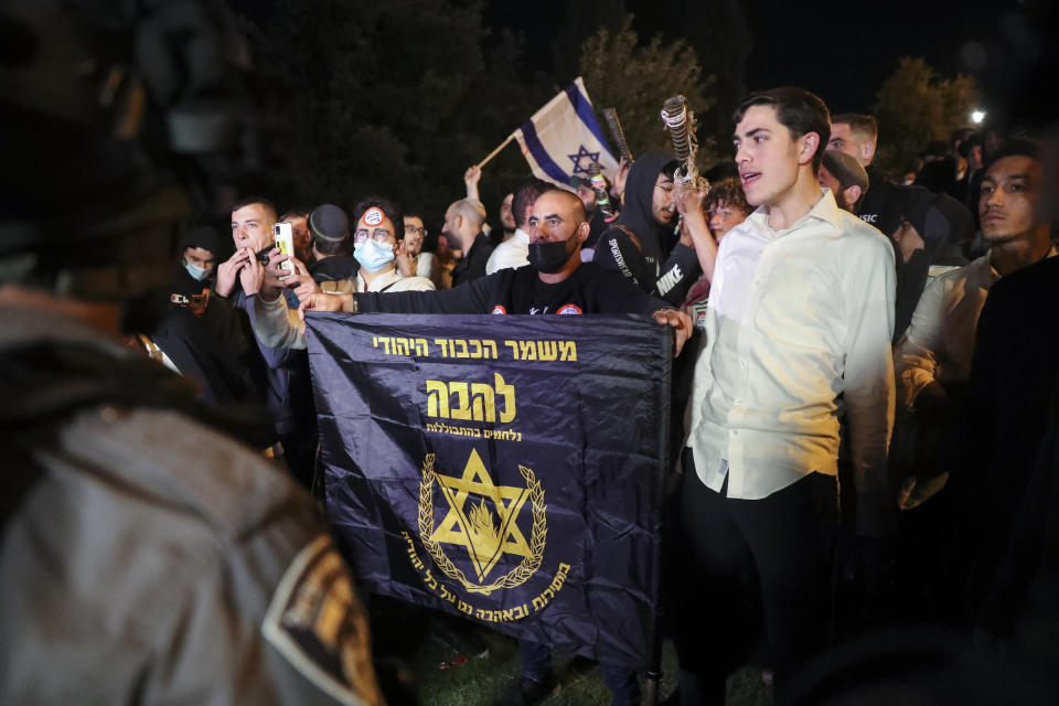 """Israeli border police block members of """"Lahava,"""" a Jewish extremist group to approach to Damascus Gate to protest amid heightened tensions in the city, just outside Jerusalem's Old City, Thursday, April 22, 2021. (AP Photo/Ariel Schalit)"""