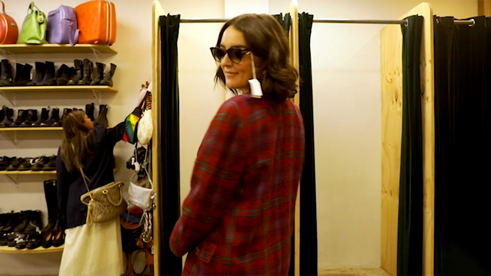 Image of reporter modelling red coat sunglasses Swop clothing exchange