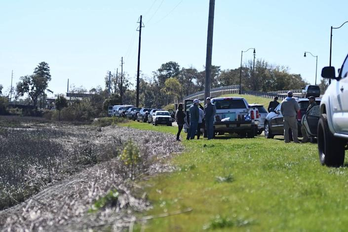 Family members of Mallory Beach waited near Archers Creek as crews continued to search for the teen on Monday afternoon, who went missing following an early morning boat crash on Sunday.