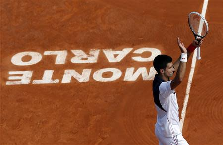 Novak Djokovic of Serbia celebrates after defeating Albert Montanes of Spain during the Monte Carlo Masters in Monaco April 15, 2014. REUTERS/Eric Gaillard