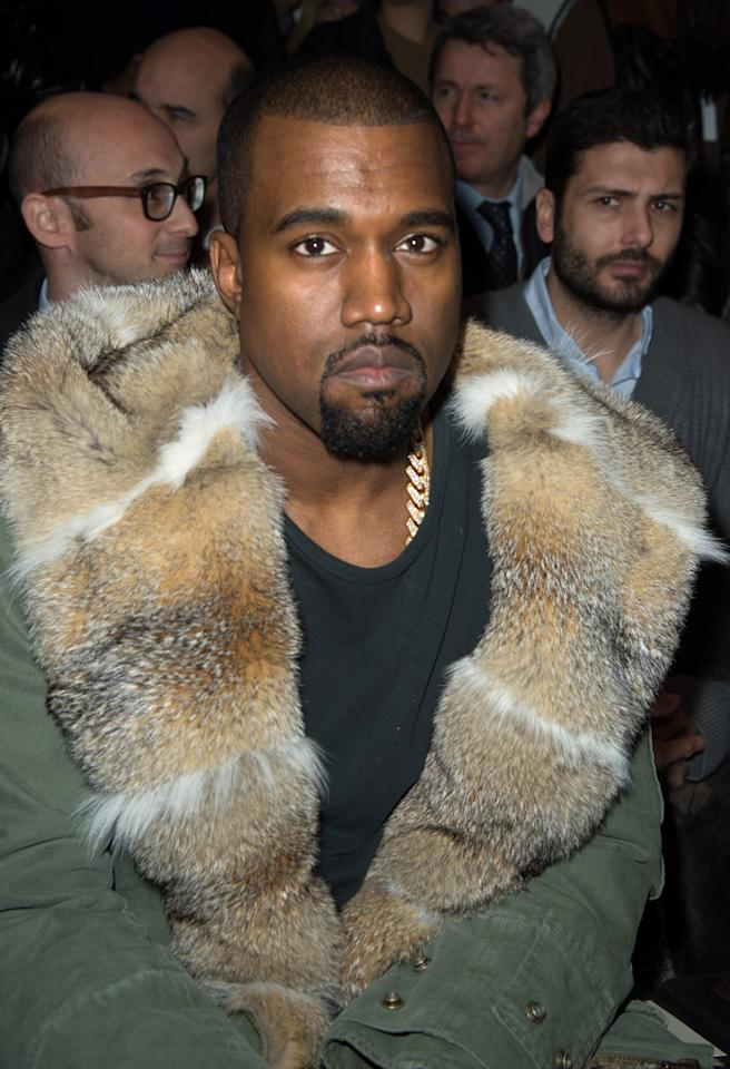 PARIS, FRANCE - JANUARY 17:  Kanye West attends the Louis Vuitton Men Autumn / Winter 2013 show as part of Paris Fashion Week on January 17, 2013 in Paris, France.  (Photo by Dominique Charriau/WireImage)