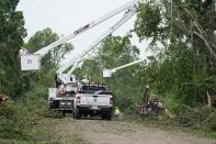 Utility linemen work on repairing power and communication lines in Yazoo County, Miss., Monday, May 3, 2021, following Sunday's tornado that destroyed a number of homes and small businesses. (AP Photo/Rogelio V. Solis)