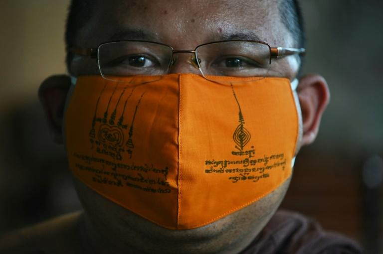 A group of innovative monks near Bangkok are turning to their Buddhist faith in a bid to help contain the new disease