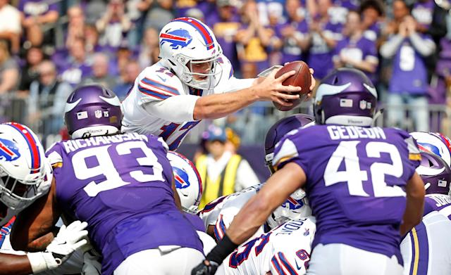 <p>Buffalo Bills quarterback Josh Allen dives into the end zone over Minnesota Vikings' Sheldon Richardson, left, and Ben Gedeon (42) during a 1-yard touchdown run in the first half of an NFL football game, Sunday, Sept. 23, 2018, in Minneapolis. (AP Photo/Bruce Kluckhohn) </p>
