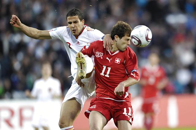 Alvaro Dominguez of Spain (L) vies for the ball against Admir Mehmedi of Switzerland during the UEFA Under-21 European Championship final football match at NRGI Park Stadium in Arhus Stadion Denmark on June 25, 2011. AFP PHOTO HENNING BAGGER/SCANPIX (Photo credit should read HENNING BAGGER/AFP/Getty Images)