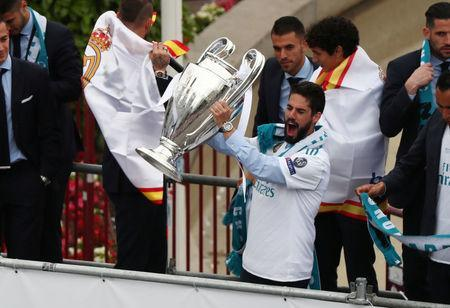 Soccer Football - Real Madrid celebrate winning the Champions League Final - Madrid, Spain - May 27, 2018 Real Madrid's Isco celebrates with the trophy during victory celebrations REUTERS/Sergio Perez